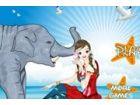 Das niedliche Mädchen ist gute Zeit mit dem Elefanten haben.